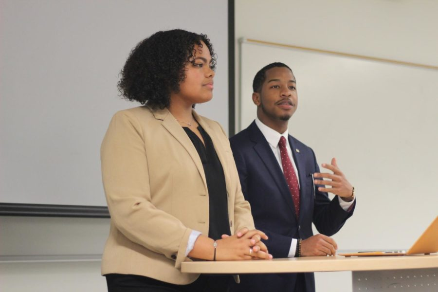 Jessamyn Reichman and Freedom Richardson discuss their policies at the SGA debate on March 12, 2019. The candidates for president, vice president, and senators all participated in the debate. Photo credit: Cristian Orellana