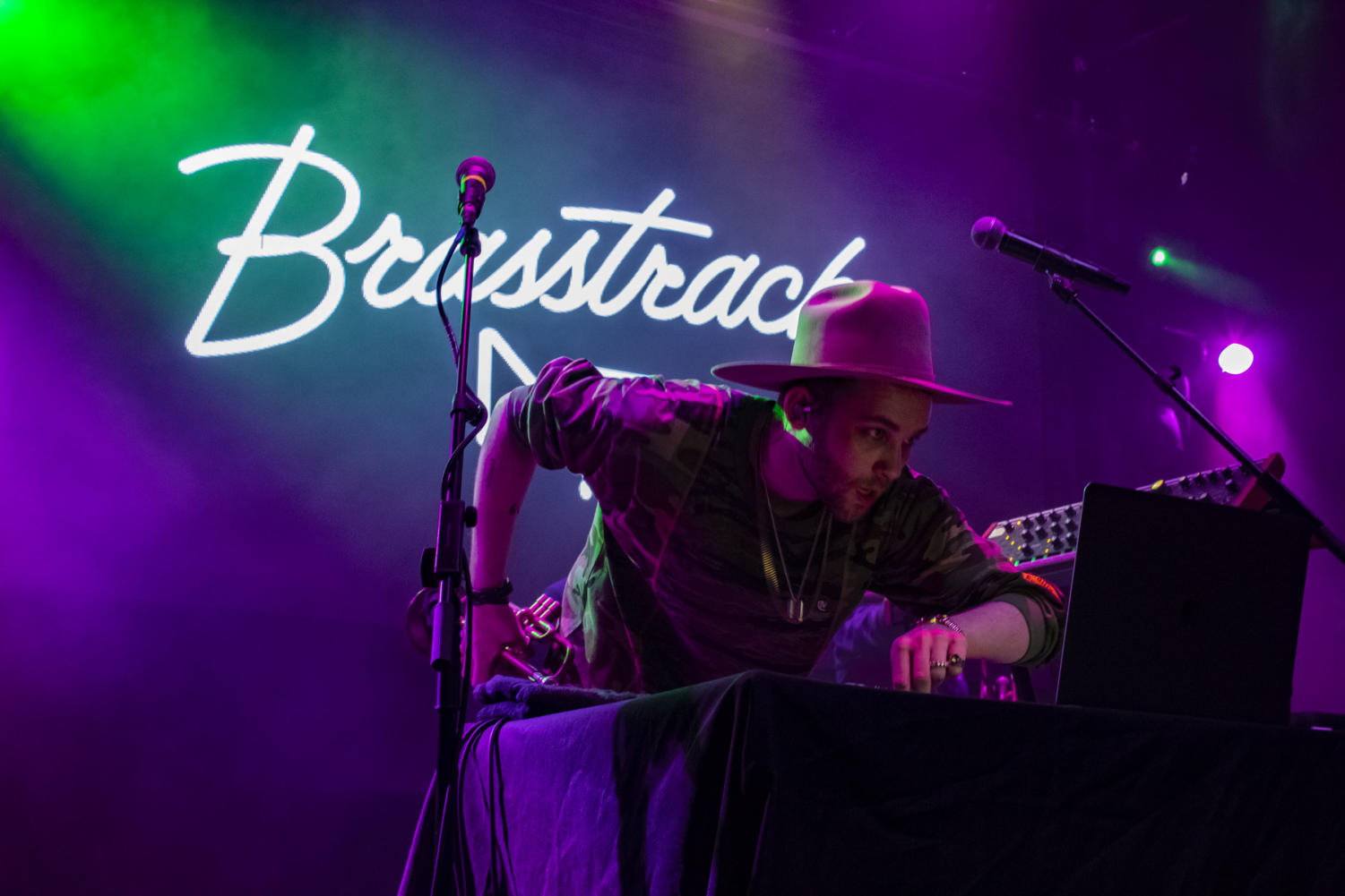 Ivan Jackson takes a break from trumpeting during the show. Brasstracks brought the bands'