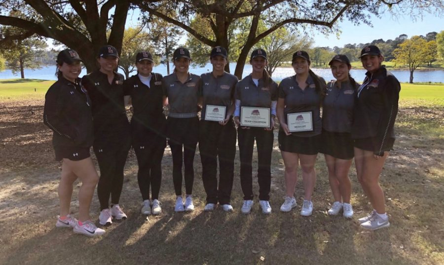 The 2019 Loyola women's golf team poses for a photo after their win at the Wolf Pack Invitational. Both teams featured individual winners at the tournament. Photo credit: Loyola New Orleans Athletics