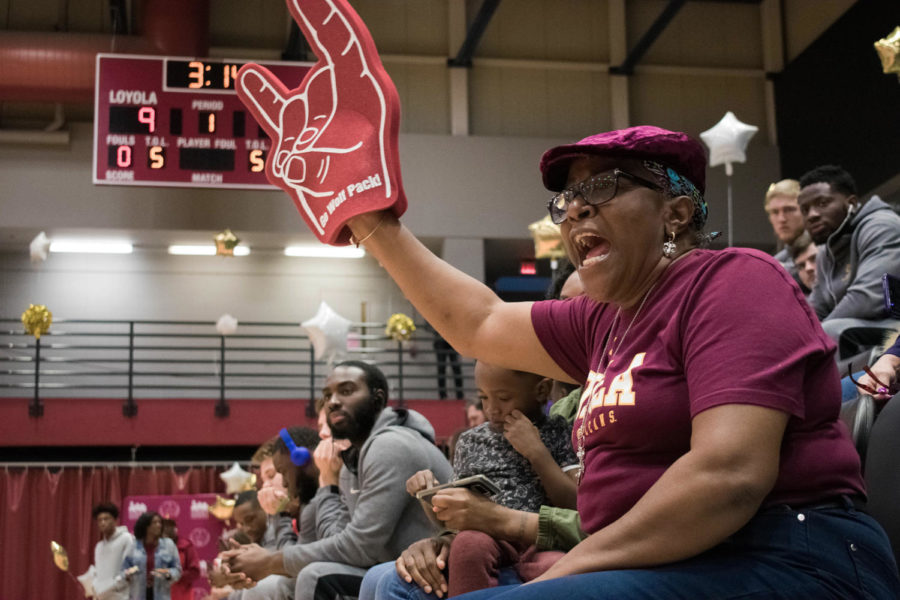 A Loyola fan cheers on the women's basketball team versus Bethel University on Feb. 14, 2019. Both teams will be competing in the national tournament this year. Photo credit: Michael Bauer