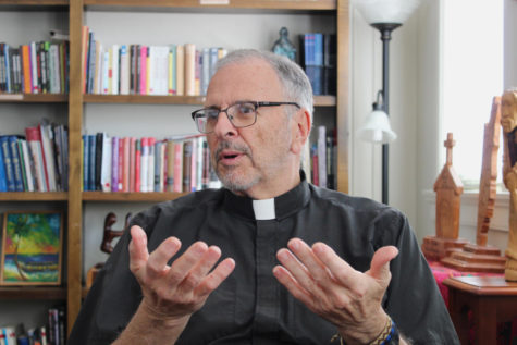 The Rev. Ted Dziak, S.J., sits in his office in the Department of Mission and Ministry on March 26, 2018. Dziak announced that he will be gping on a year-long sabbatical as well as resigning from his role as Vice President for Mission and Identity. Photo credit: Jawdat Tinawi