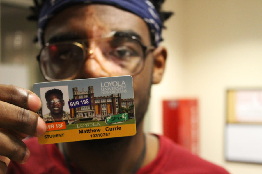 Matthew Currie, music industry freshman, shows his Loyola student ID upon entering Biever Hall on March 5, 2019. Last month, the university implemented a policy that requires students to show their IDs upon entering a residence hall or face a fine. Photo credit: Jawdat Tinawi