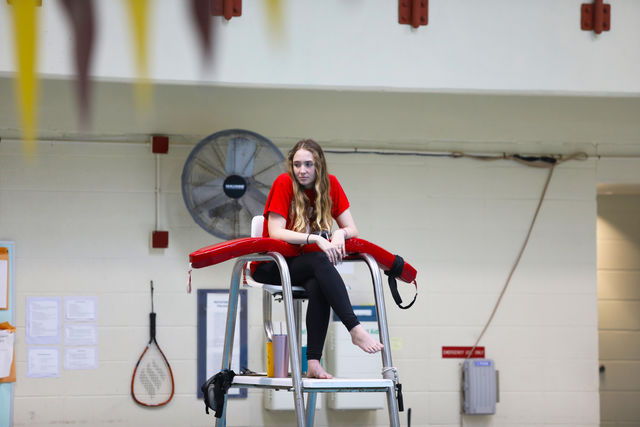 Business senior Robyn Caire watches over the pool from her lifeguard chair in the University Sports Complex.