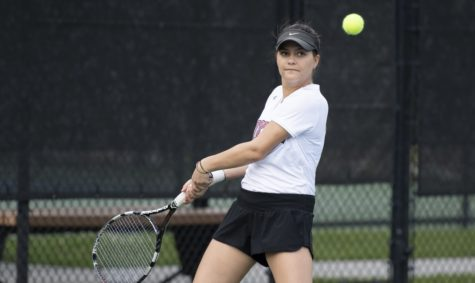 International business sophomore Manuela Alban would continue the Wolf Pack's success in singles play. Alban won her with a perfect 6-0, 6-0 in court two, but the Crusaders would win out the remaining for matches, leaving them as the victors. Photo credit: Kyle Encar