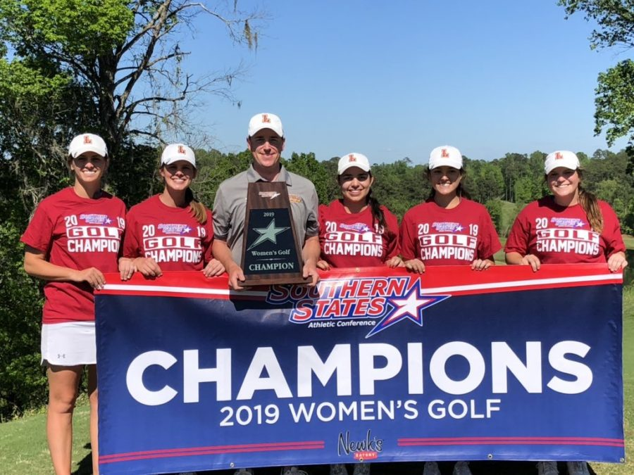 2019 Loyola golfers and head coach Drew Goff pose with their championship banner and trophy after their conference win on April 10, 2019. Photo credit: Jose Bedoya
