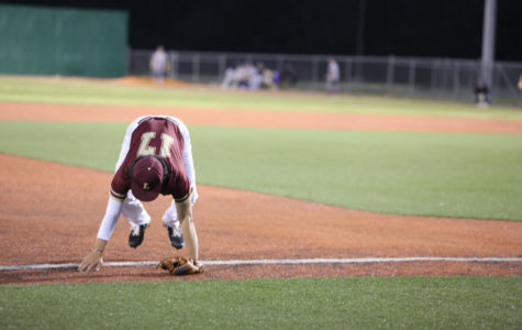 Business analytics freshman Patrick Chen See (17) falls after missing a foul ball. Loyola's baseball team sits in the bottom of the conference standings without a win against Southern States Athletic Conference team. Photo credit: Andres Fuentes