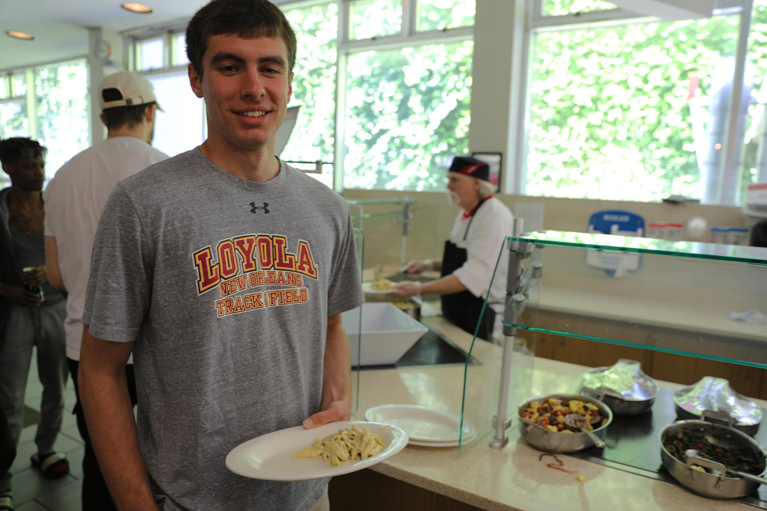 Environmental studies sophomore Liam Donovan picks up a plate of pasta in the Orleans Room. Wolf Pack athletes try their best to maintain a healthy diet.