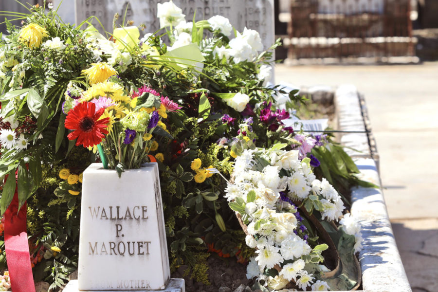 A large assortment of flowers are laid at the grave of Wallace Marquet.  Several graves had flowers to help remember passed loved ones. ANDRES FUENTES/The Maroon.