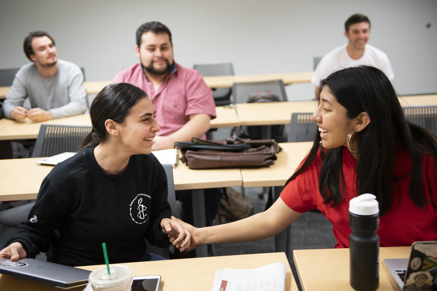 Rana Thabata finds out she was one of 62 winners of the prestigious Truman Scholarship in her business class. Tetlow, a former Truman fellow herself, came to her class with balloons to announce Thabta's win. Photo credit: Kyle Encar