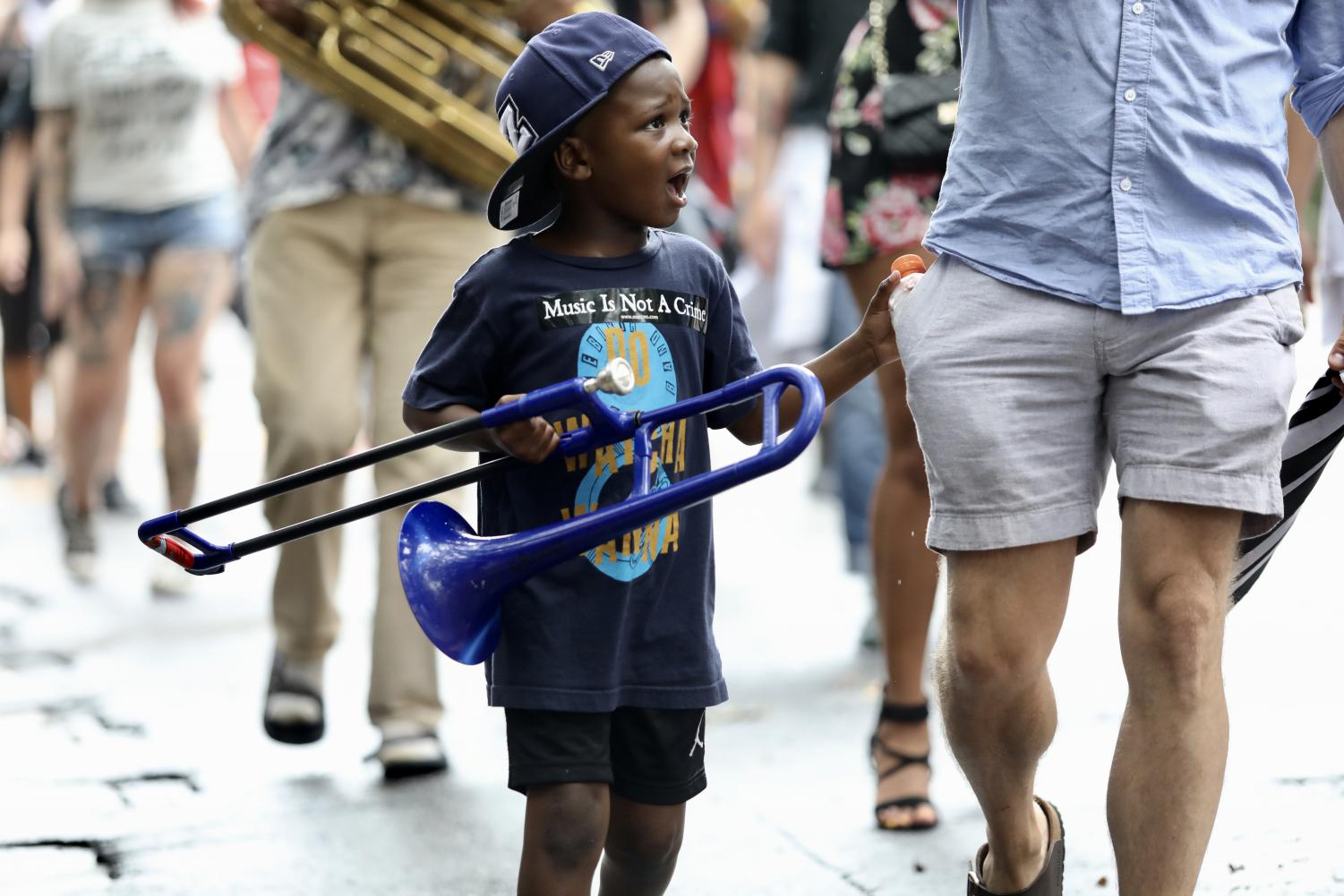 A child brought his trombone to perform in the second line for Eugene Grant on July 21, 2019.