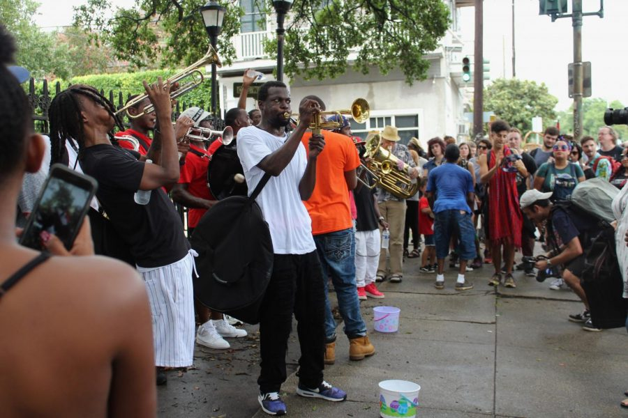 The rally band plays in front a crowd of followers. People left money for Eugene Grant in buckets on the ground.