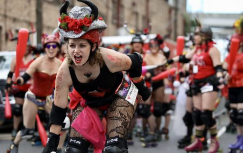 A member of the Big Easy Rollergirls charges the runners of San Fermin in Nueva Orleans on August 25, 2019.