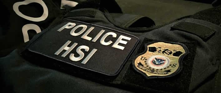 An armored vest displays a Homeland Security Investigations badge. HSI participated in the Aug. 14 raid.