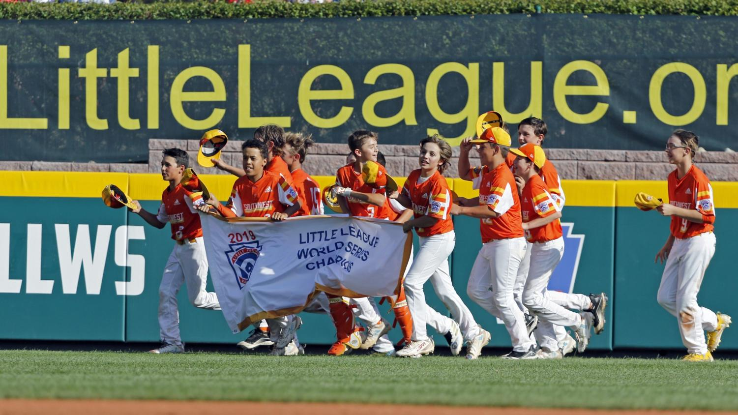River Ridge, Louisiana's Alton Shorts, River Ridge, Louisiana's Stan Wiltz, Ryder Planchard and Derek DeLatte carry the championship banner around the stadium as they celebrate the 8-0 win against Curacao in the Little League World Series Championship game in South Williamsport, Pa., Sunday, Aug. 25, 2019. (AP Photo/Tom E. Puskar)