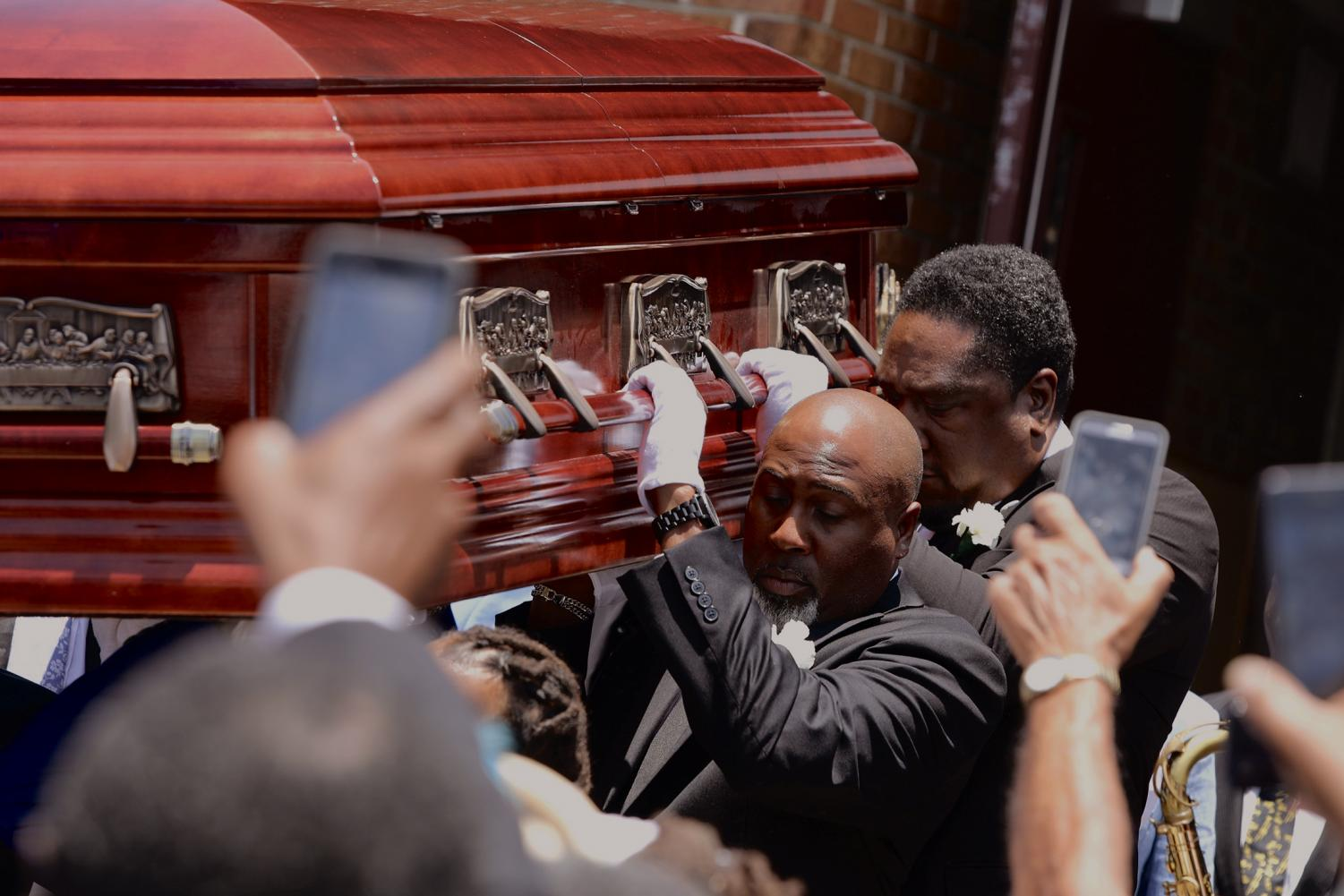 Family members carry Dave Bartholomew's casket out of St. Gabriel the Archangel Roman Catholic Church on July 8, 2019. A stationary second line took place afterward with the Treme Brass Band. Photo credit: Andres Fuentes
