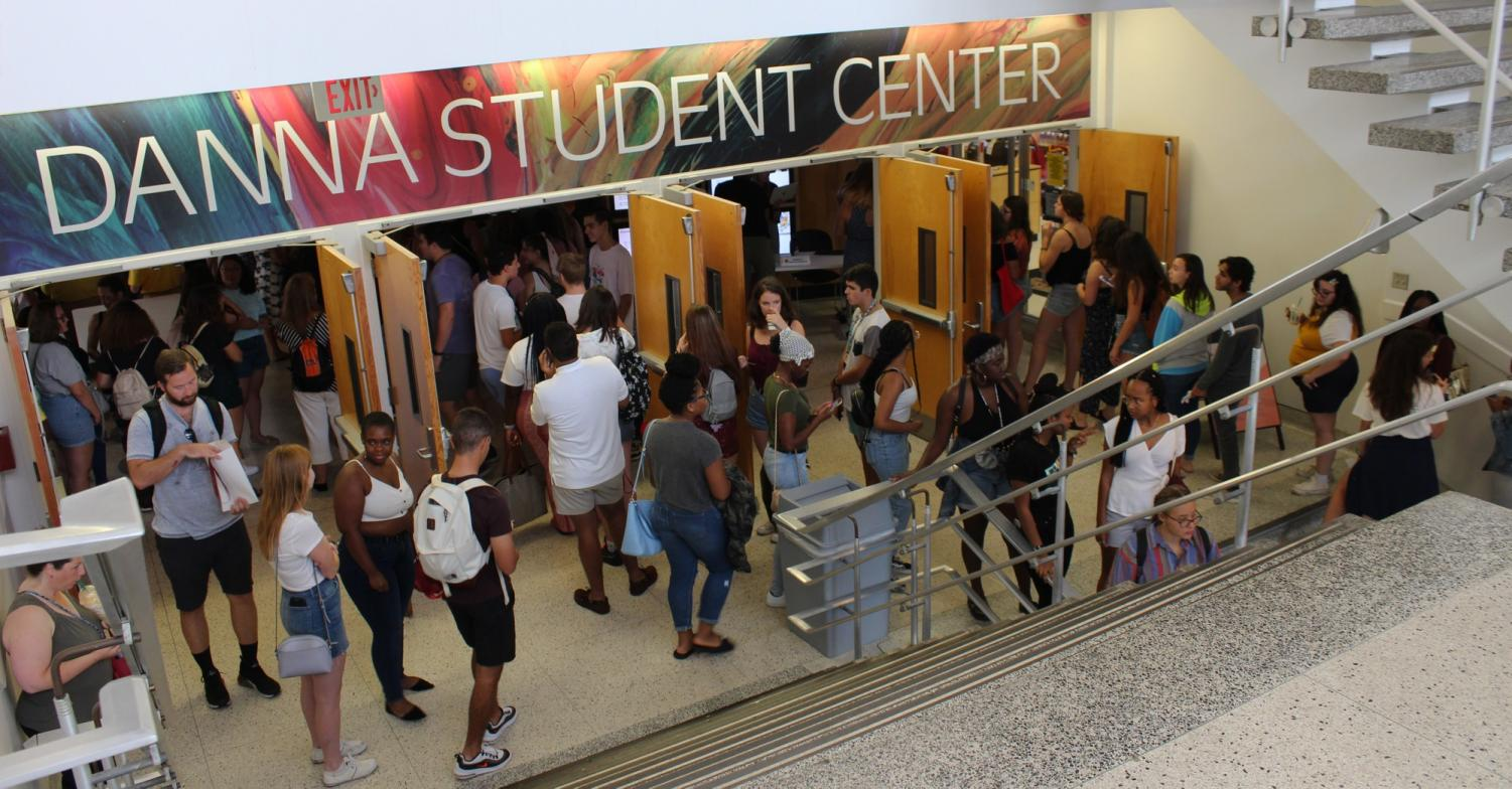 Freshmen scattered around the entrance of the Danna Center. Overcrowding is an issue on people's minds as our student body grows yearly. Cristian Orellana/The Maroon