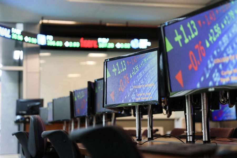 Stock+prices+scroll+across+the+computer+monitors+in+the+trading+room+on+Aug.+21%2C+2019.+Loyola+students+made+money+on+their+investments+last+week+despite+market+volatility.+Photo+credit%3A+Michael+Bauer