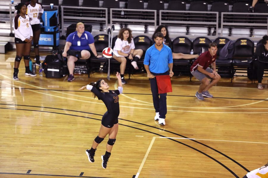 Psychological sciences, pre-health junior Helene Masonne serves against Xavier University of Louisiana. Masonne finished with 13 digs against Xavier. Photo credit: Andrew Lang