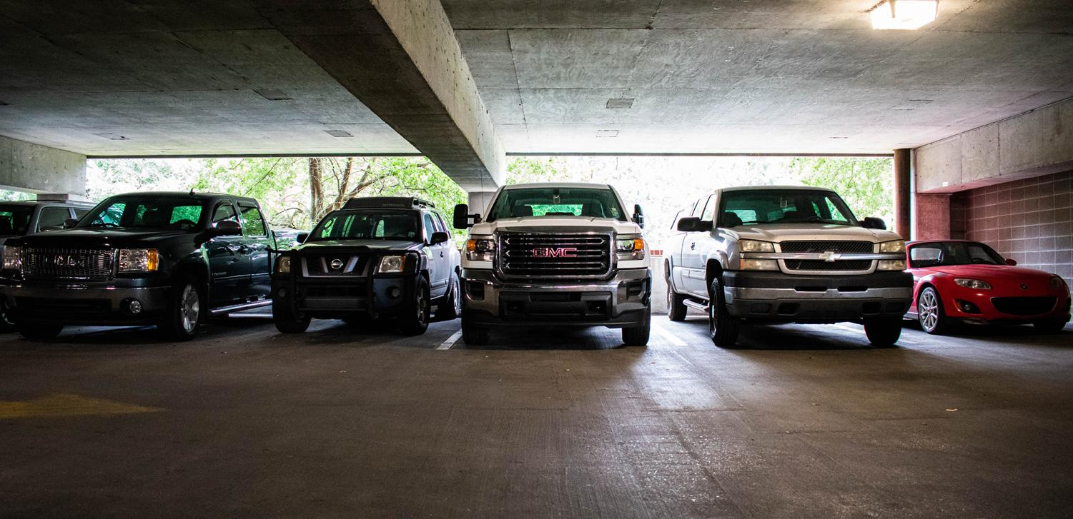 Cars in the Freret Street parking garage back into spaces despite new parking policies. Backing into a space will now lead to a citation from LUPD. Photo credit: Michael Bauer