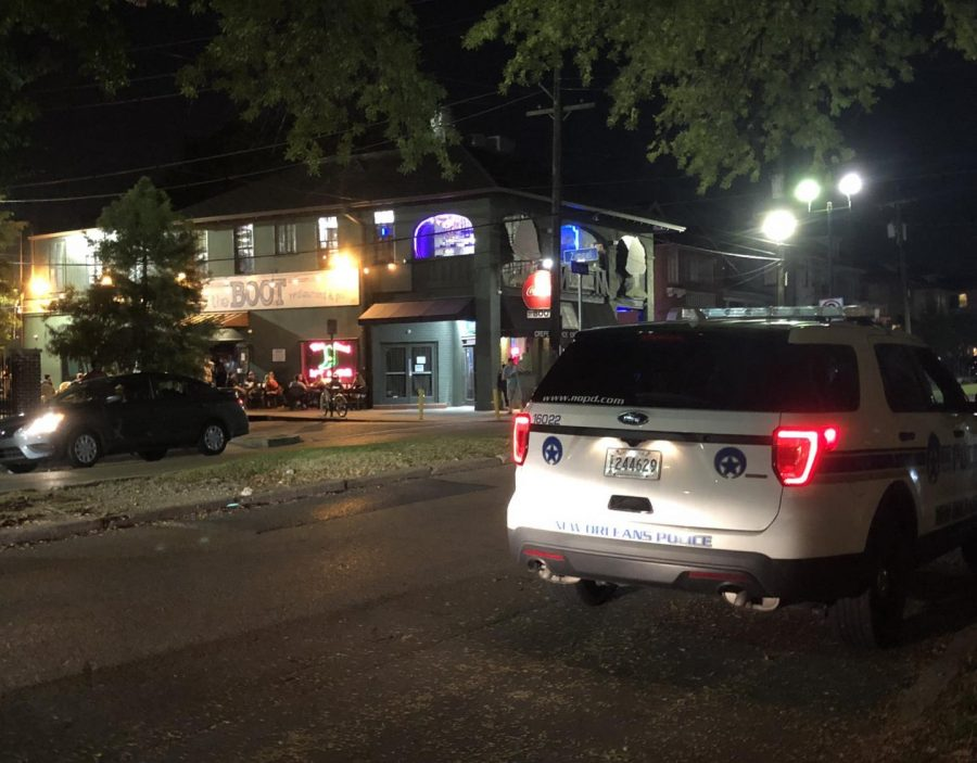 A police car sits on Broadway Street outside The Boot Bar & Grill on Sept. 6. The recent reports of sexual assaults linked to the Uptown bar have led to an increase police presence in the area.