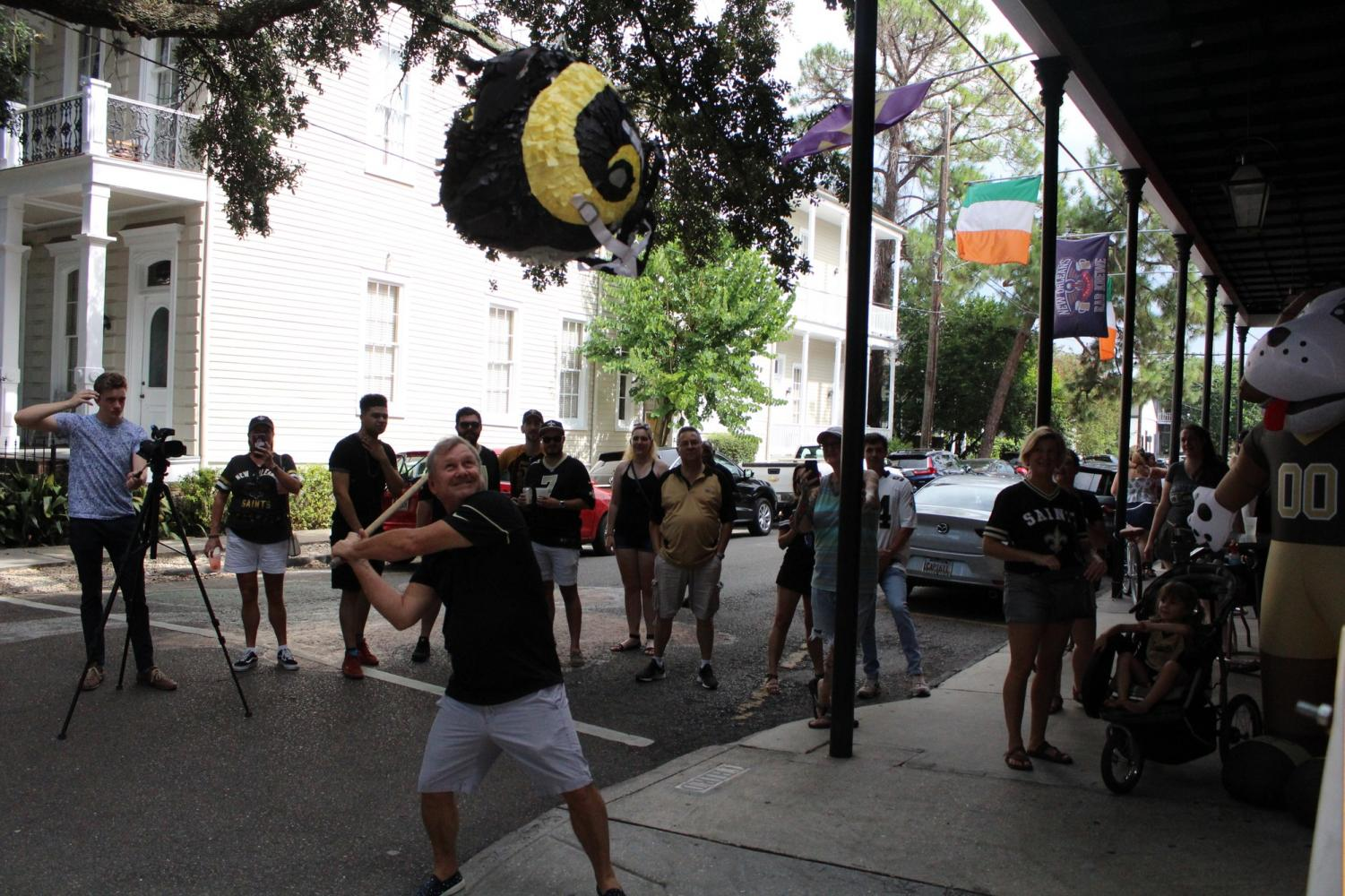Fans line up to crack open a L.A. Rams pinata ahead of the Saints vs. Rams game on September 15, 2019. Saints fans did their best to release their frustration before the game. Photo credit: Andres Fuentes