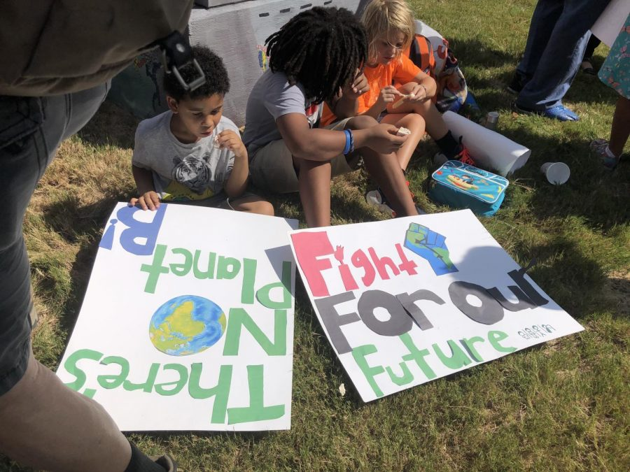 Children+sit+with+signs+at+the+New+Orleans+climate+strike+on+Sept.+20.+The+strike+was+part+of+a+week+long+protest+that+spread+across+six+continents+to+raise+awareness+for+climate+change.+Photo+credit%3A+Raegan+Walberg