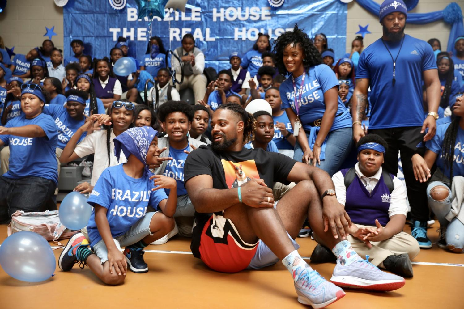 New Orleans Saints defensive end Cam Jordan takes his day off to visit students at KIPP Leadership Academy on September 3, 2019. Jordan and other organizations gave the school 400 backpacks and $10,000 to help with school activities. Photo credit: Andres Fuentes