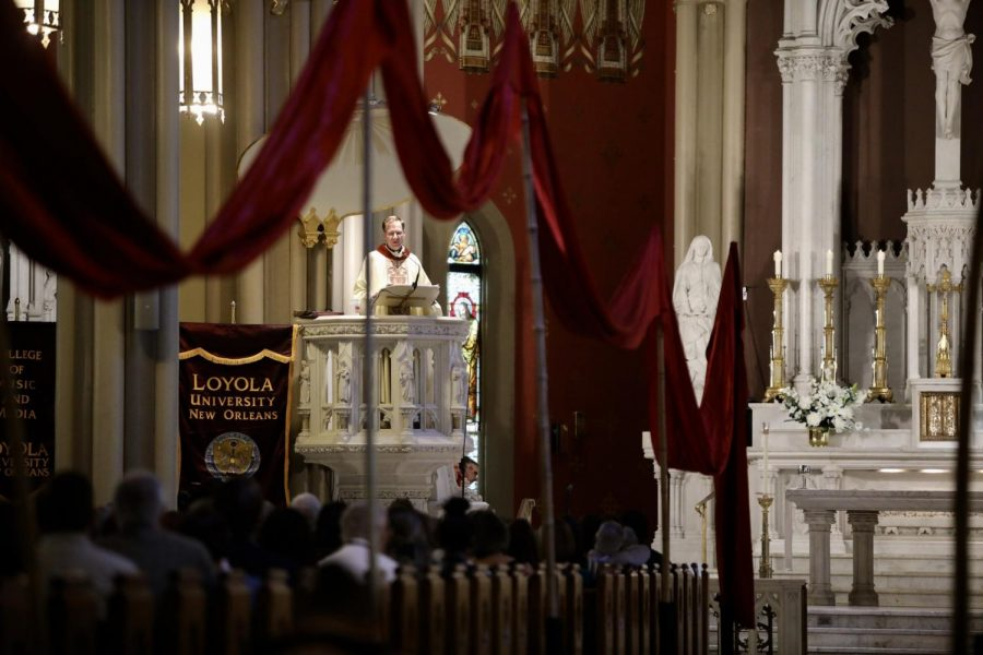 Red+banners+hang+from+poles+all+throughout+the+aisles+of+the+Holy+Name+of+Jesus+church+for+the+Mass+of+the+Holy+Spirit+on+September+5%2C+2019.+The+mass+has+an+over+500+year+old+tie+to+Jesuit+tradition.+Photo+credit%3A+Andres+Fuentes