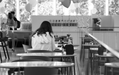 A student eating at the new Commons dining hall. This is just one of the few things Loyola and Tulane share. Hannah Renton/the Maroon.