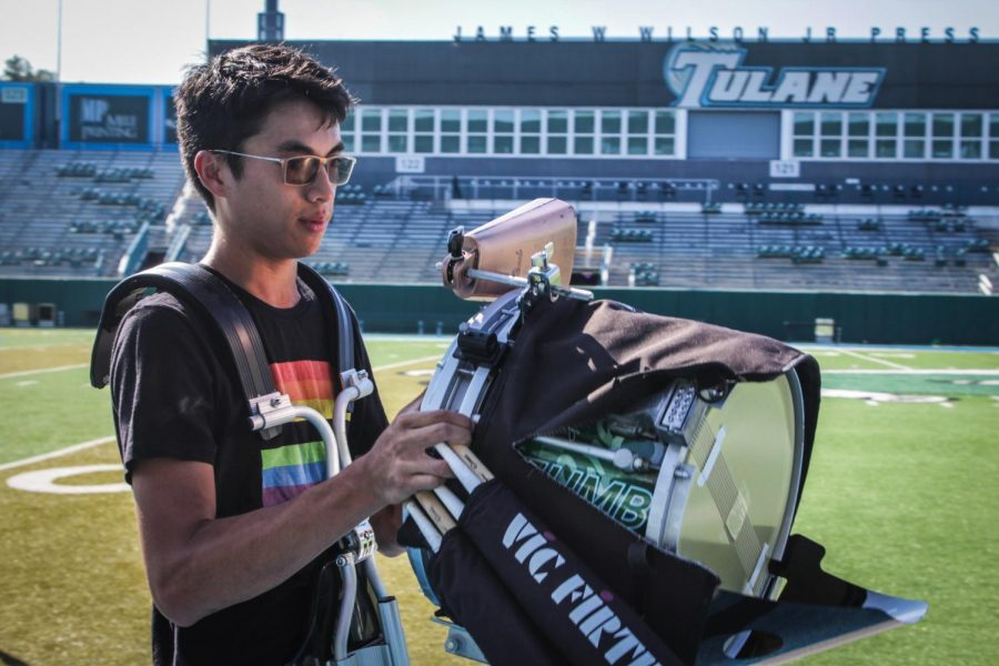Demetrio+%22Dane%22+Castillo%2C+music+composition+senior%2C+adjusts+his+snare+drum+equipment+before+marching+band+practice+at+Yulman+Stadium%2C+Aug.+30.+Castillo+is+one+of+three+Loyola+students+who+march+and+perform+with+Tulane%27s+marching+band.+Photo+credit%3A+Rose+Wagner