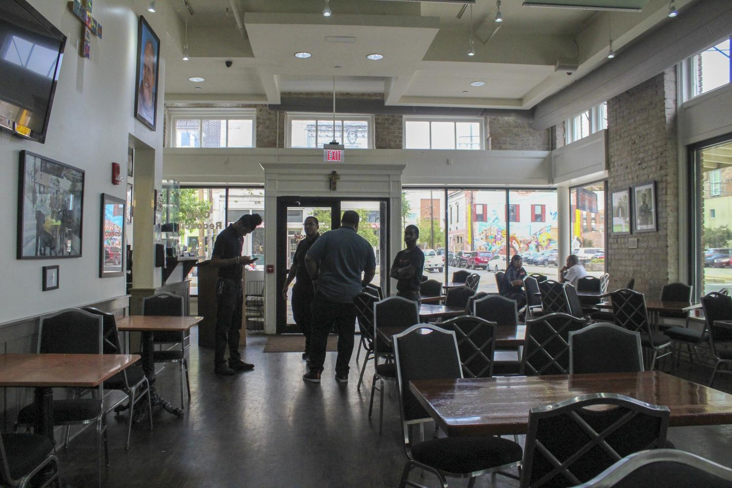 Café Reconcile employees talk right before closing time on Sept. 13th. Café Reconcile has many programs for underprivileged youth in New Orleans. Photo credit: Cristian Orellana