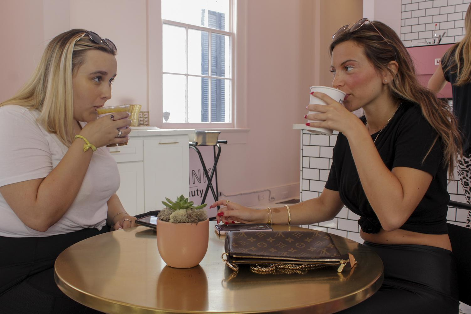 Loyola students Lily Glennon and Tess Rowland enjoying their drinks on Aug. 17, 2019. Drink Beauty is a cashless business, so all order transactions are made digitally. Photo credit: Caitlyn Reisgen