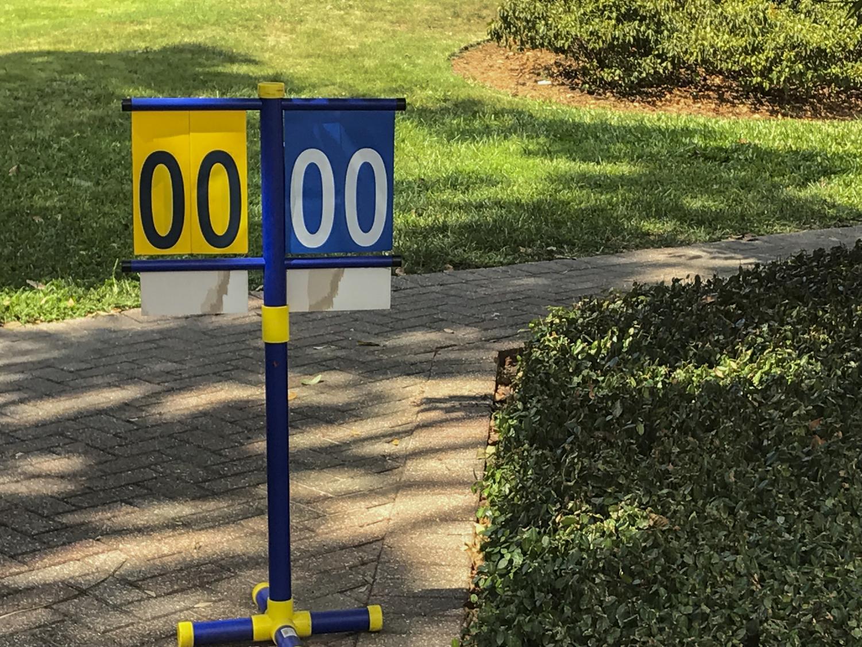 A lonely scoreboard sits unattended in the Peace Quad. The cornhole tournament on Sept. 25, did not happen. Brendan Heffernan/the Maroon.