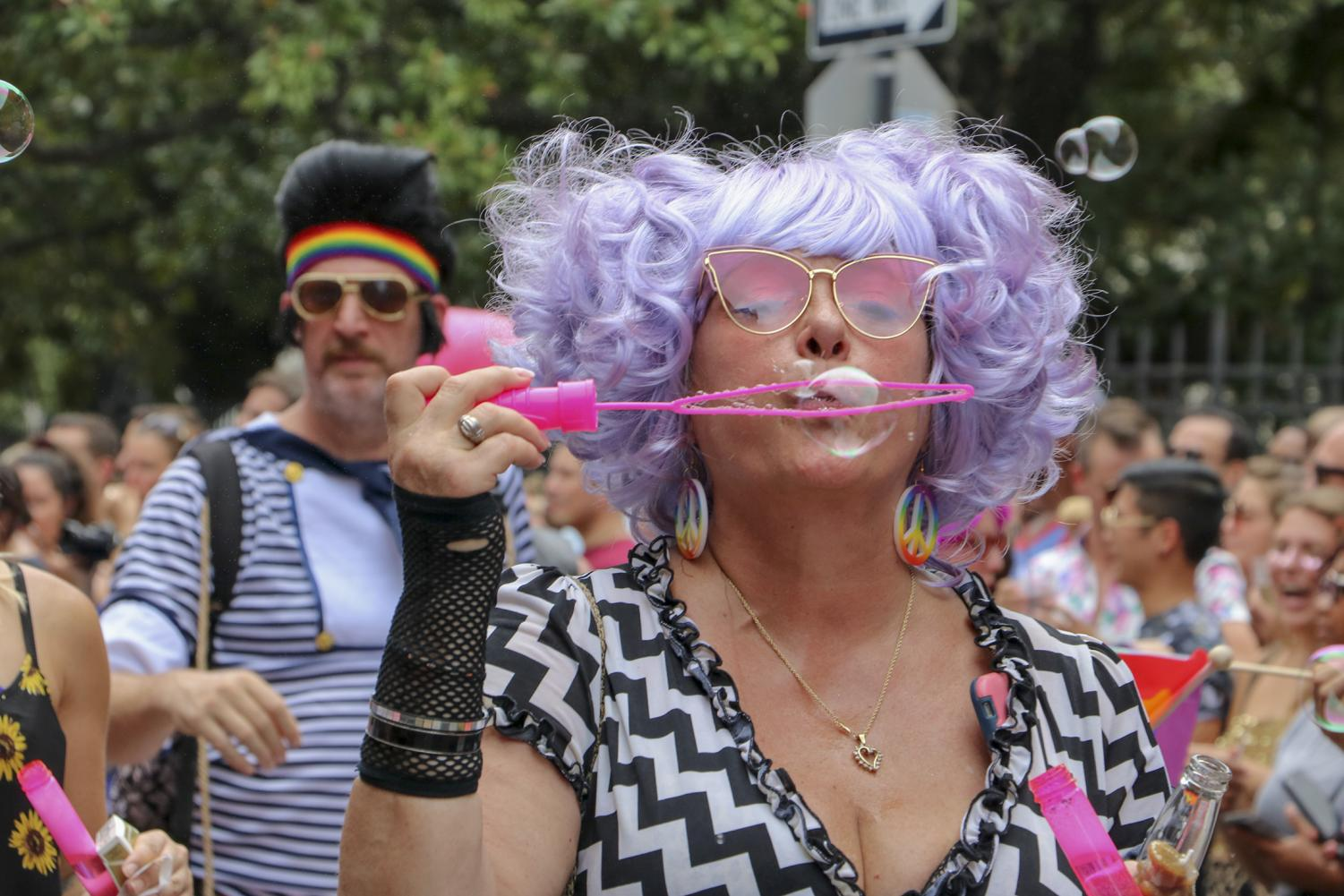 Parade-goer blows bubbles in the 48th Southern Decadence Parade. The event celebrates the LGBTQ+ community. Photo credit: Hannah Renton