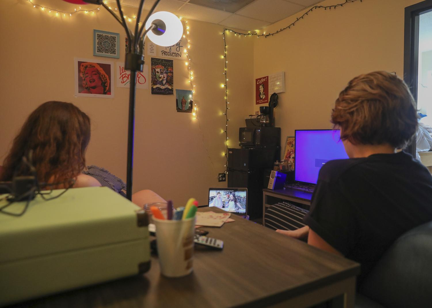 Juniors Grace Hawkins and Allie Waguespack watch cable on a laptop in their dorm room on Sept. 11, 2019.