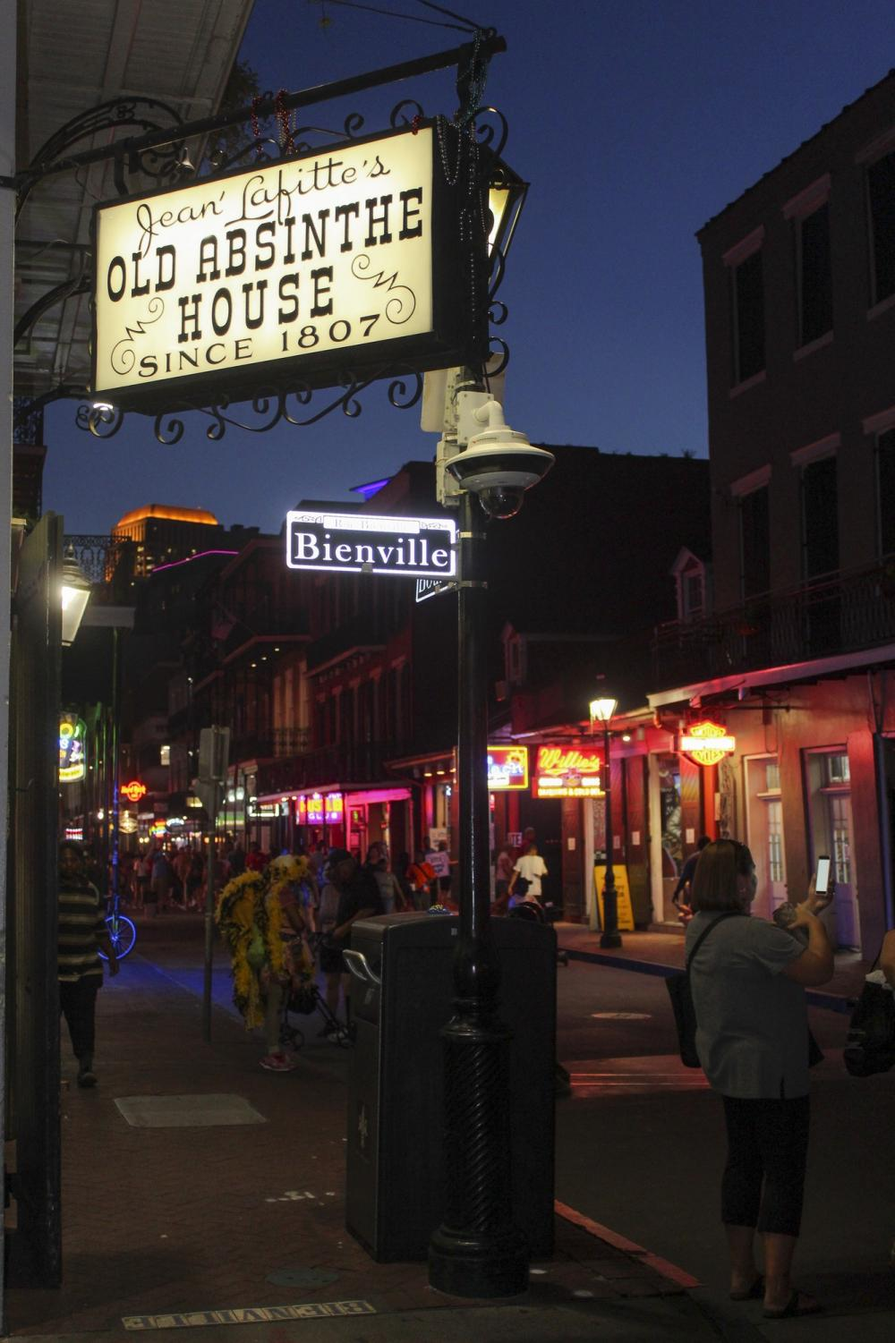 The outside of The Old Absinthe House bustles on the corner of Bienville Street and Bourbon Street on Sept. 10. The bar is among the oldest bars in the city. Photo credit: Gabriella Killett