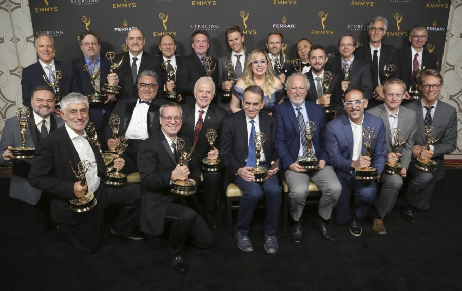 IMAGE DISTRIBUTED FOR THE TELEVISION ACADEMY - Actress Kirsten Vangsness, center, poses with the winners of the Engineering Emmy Awards at the 71st Engineering Emmy Awards, presented by the Television Academy at the JW Marriott Los Angeles L.A. LIVE hotel on Wednesday, Oct. 23, 2019 in Los Angeles. (Photo by Willy Sanjuan/Invision for The Television Academy/AP Images)