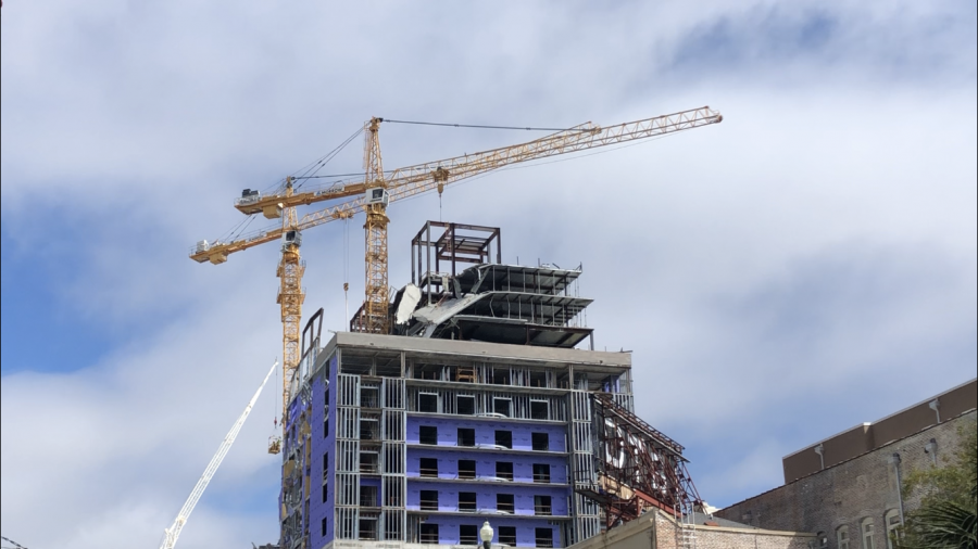 Two cranes secure the Hard Rock Hotel after it collapsed last weekend. The planned demolition of the two cranes has been rescheduled for a second time. Photo credit: Erin Snodgrass