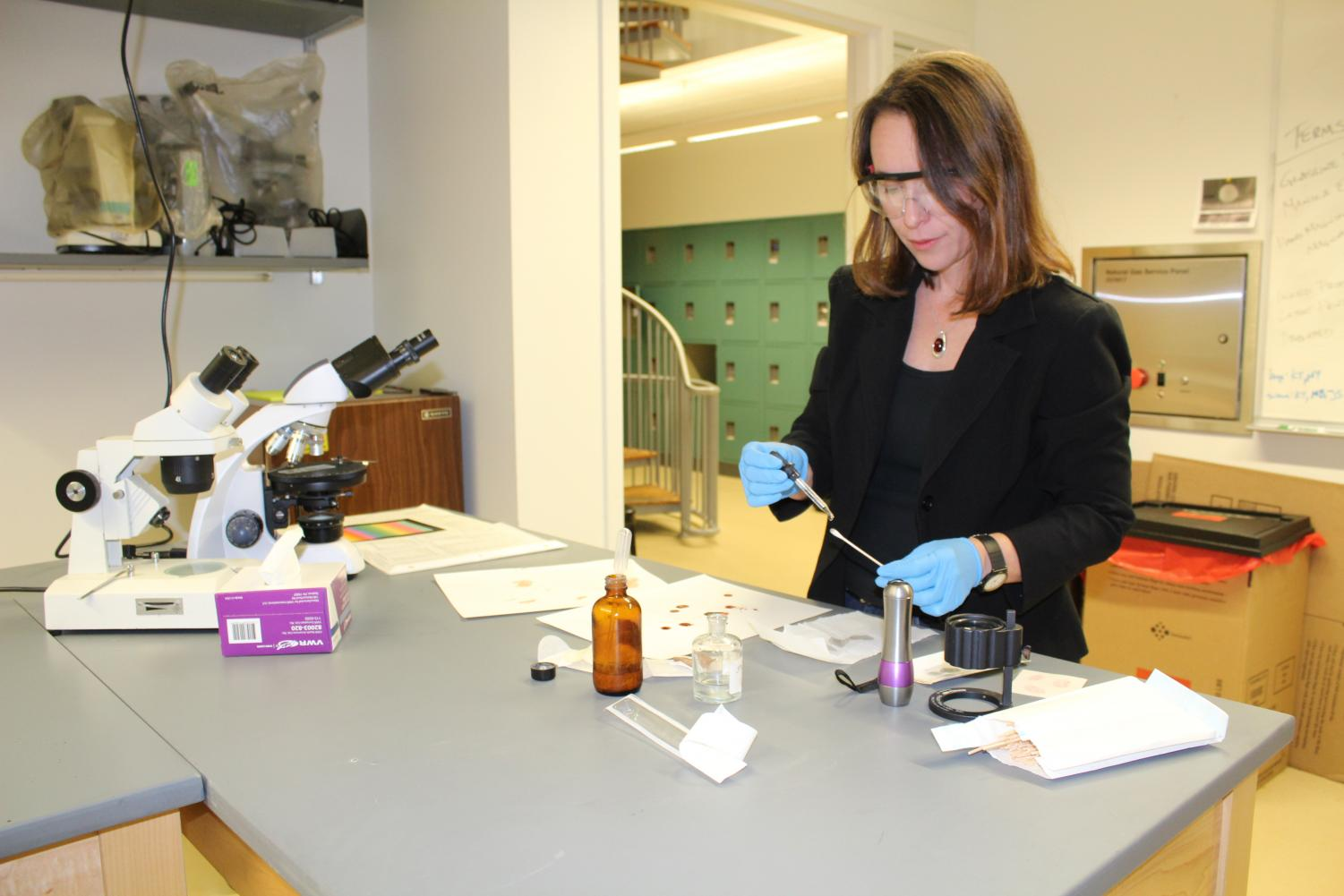 Director of Forensic Chemistry Anna Duggar demonstrates a forensic blood spatter examination and analysis. Duggar is a blood spatter analysis expert who worked alongside various police department crime scene labratories and teaches forensic analysis at Loyola.