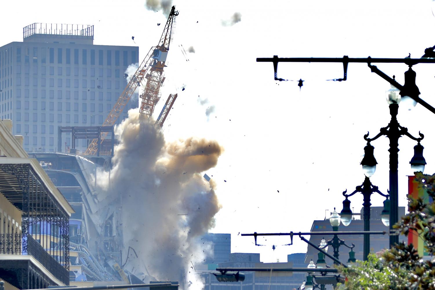 One of the unstable cranes at the Hard Rock Hotel starts to fall onto North Rampart Street after a controlled detonation on October 20, 2019. Photo credit: Andres Fuentes