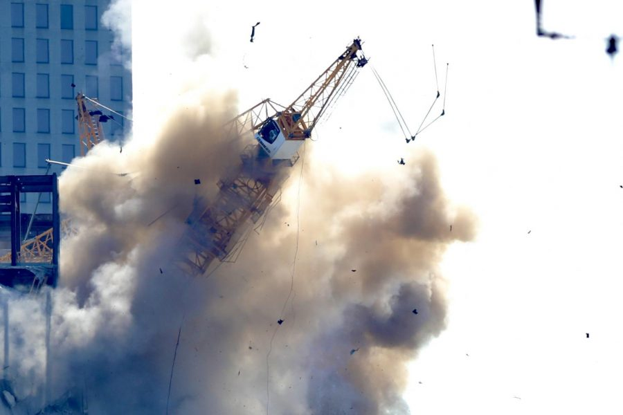 A cloud of dust forms after explosions caused one of the unstable cranes to collapse at the Hard Rock Hotel on October 20, 2019.