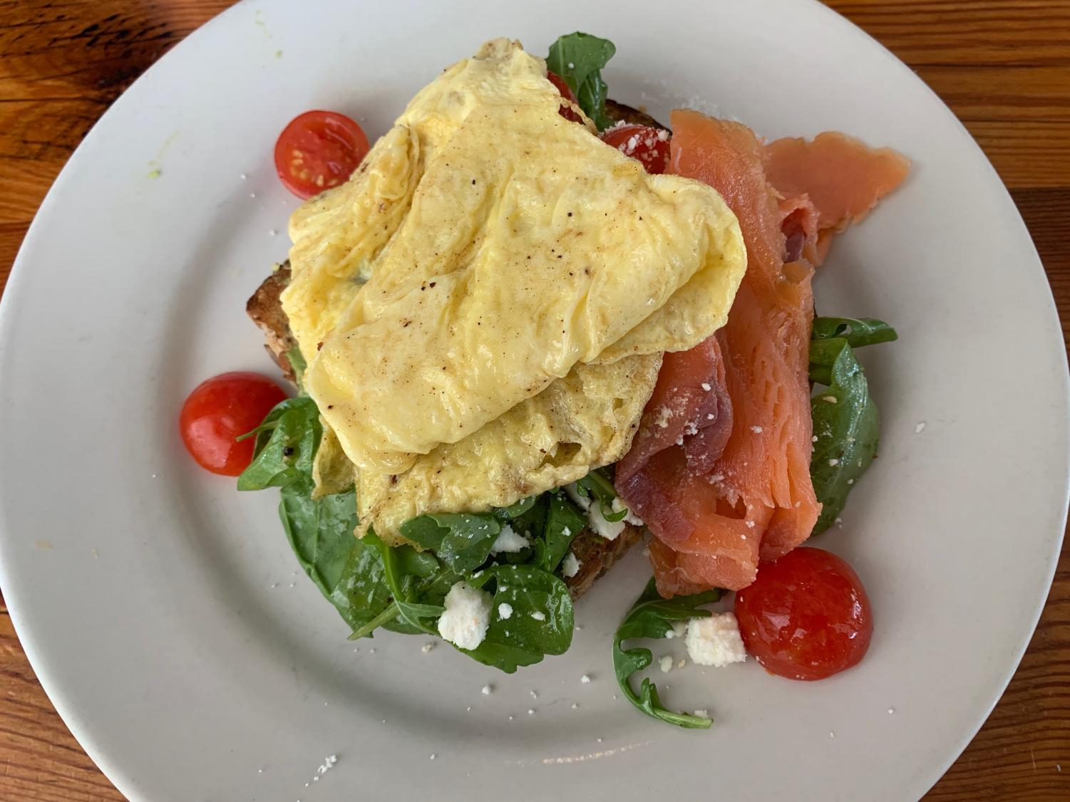 Satsuma's omelet with avocado toast and smoked salmon with tomatoes and spinach sits on a plate on a Sunday morning. This is a go-to for many restaurant patrons. Photo credit: Valerie Cronenbold