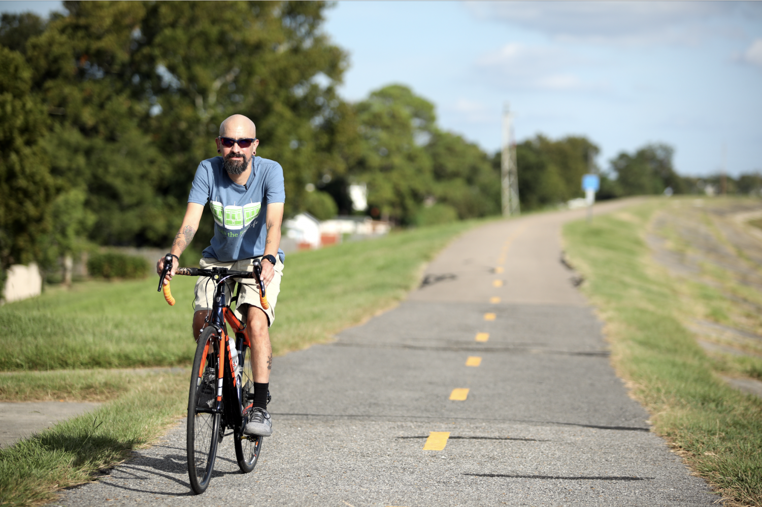 Frankie Avila rides his bike on the levee in Rivertown, Kenner. Photo Credit: Andres Fuentes