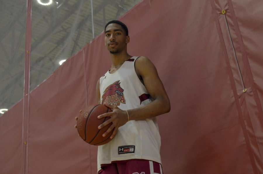 Myles Burns poses with a ball in his hands at practice, Sept. 20, 2019.  The men's basketball team will open up their season in the Den against Southeatern Baptis College on Oct. 26, 2019.  Gabrielle Korein/The Maroon