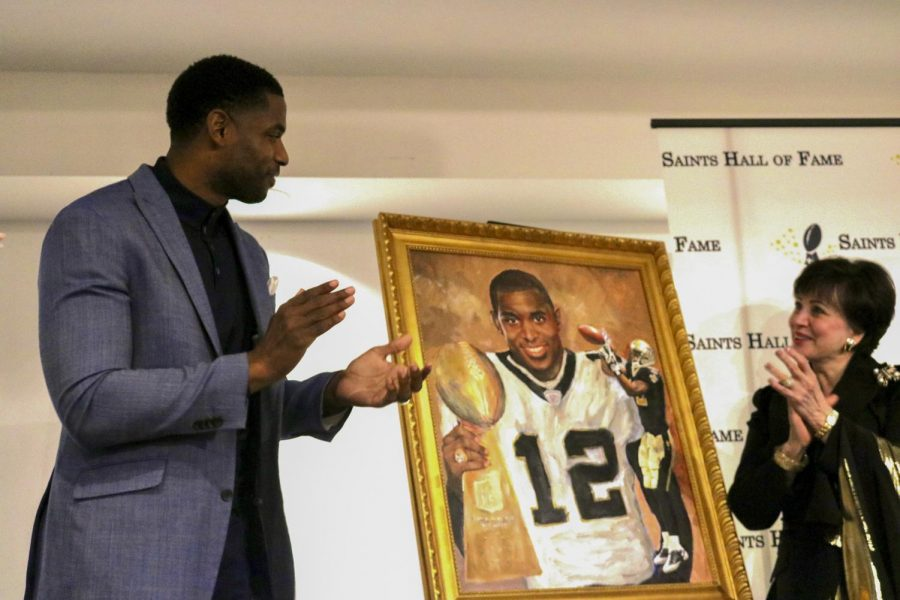 Former New Orleans Saints wide reciever Marques Colston unveils his Hall of Fame portrait with owner Gayle Benson on Oct. 26, 2019. Photo credit: Andres Fuentes