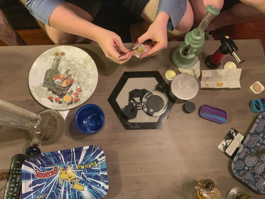 A+college+student+uses+a+metal+nail+to+break+off+a+piece+of+wax+concentrate+before+inhaling+its+vapor+to+get+high+Sept.+10.+Earwax-like+marijuana+concentrates+have+been+known+to+elicit+extreme+highs+and%2C+sometimes%2C+psychotic+behavior%2C+according+to+Special+Agent+Randy+Ladd+of+the+Denver+Division+of+the+DEA.+