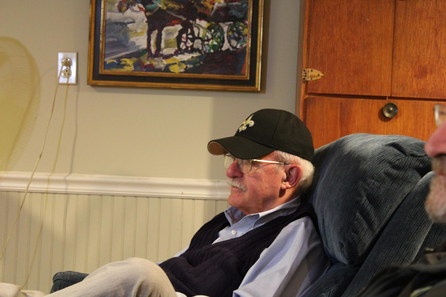 Rev. Fred Kammer, S.J. enjoys the New Orleans Saints vs. Tampa Bay Buccaneers game on his recliner on November 17, 2019. Photo credit: Madison Mcloughlin
