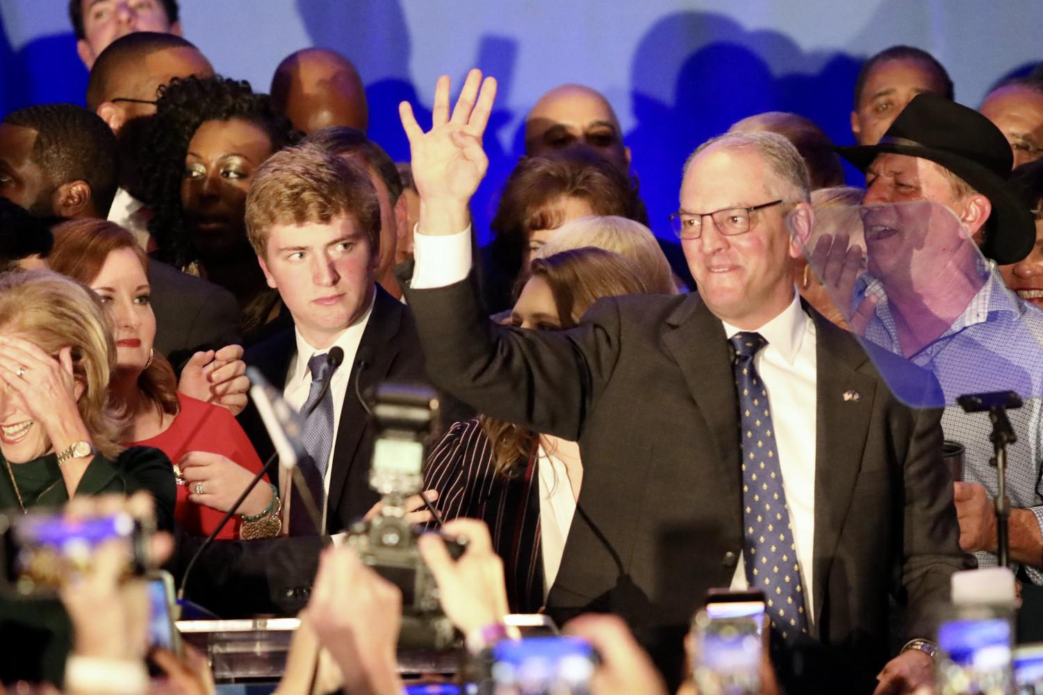 Governor John Bel Edwards holds up four fingers as he is introduced after his re-elction victory. Photo credit: Andres Fuentes