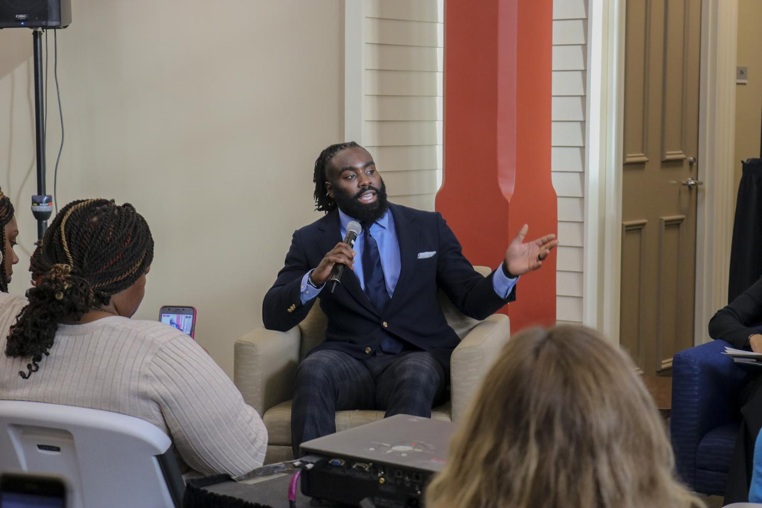 New Orleans Saints Linebacker Demario Davis talks at a town hall meeting on November 5, 2019 at Corpus Christi Church. The meeting was to raise awareness for the budget issues Orleans Public Defenders are facing. Photo credit: Andres Fuentes