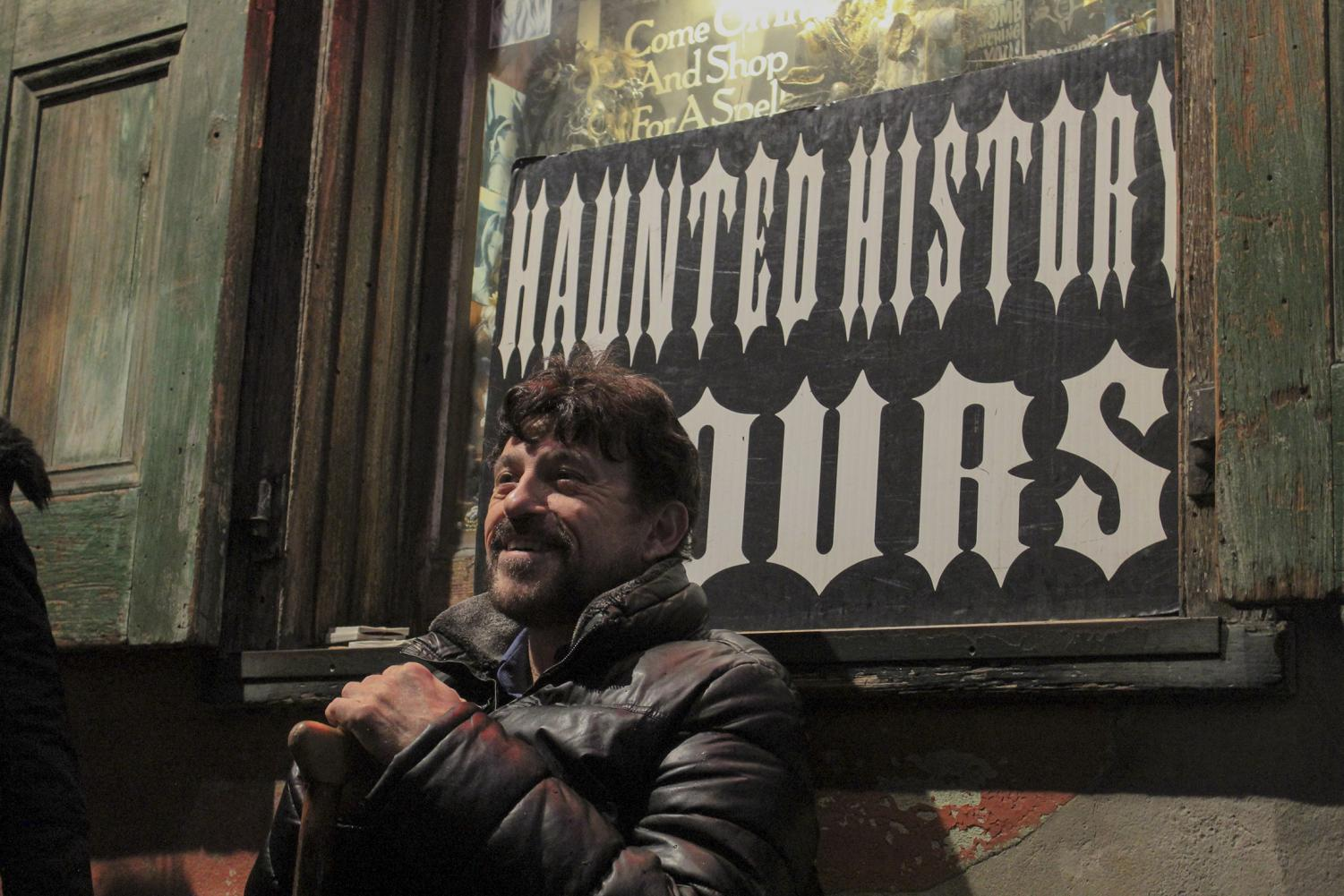 Sidney Smith, owner of Haunted History Tours, waits outside of Rev. Zombie's House of Voodoo shop for the ghost tour to begin. Haunted History Tours has been delivering gruesome tales and showcasing haunted sites throughout the French Quarter since 1995. Photo credit: Andres Fuentes